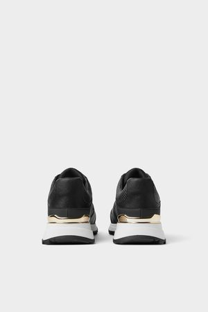 Zara Sneakers met goudkleurige accenten