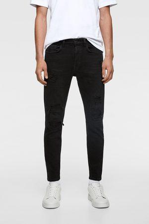 Zara Skinny jeans met scheuren onderaan de pijp
