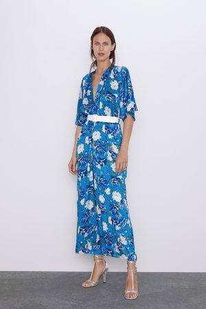 Zara Jumpsuit met bloemenprint en ceintuur