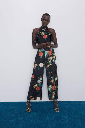 Zara Jumpsuit met bloemenprint en split