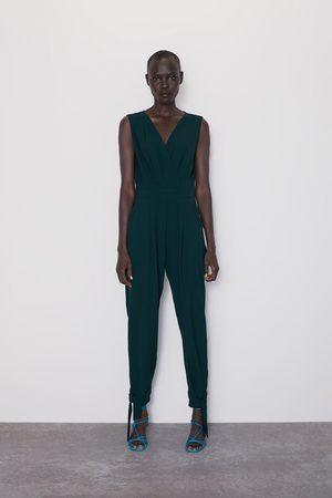 Zara Dames Pantalons - Wikkeljumpsuit met strikjes