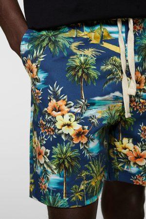 Zara Bermuda met tropische print