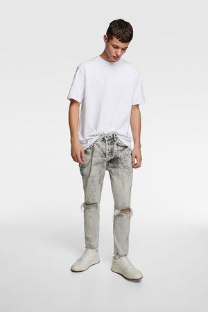 Zara Slim jeans met kettingen