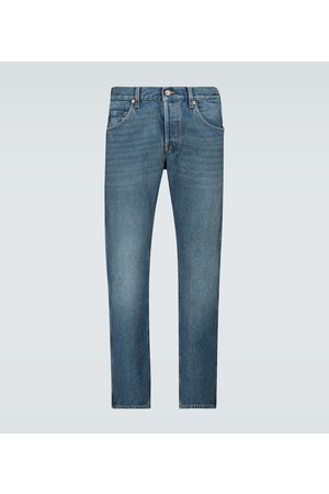 Gucci Washed denim tapered jeans