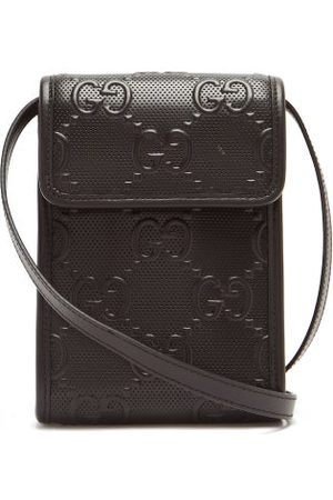 Gucci GG-logo Quilted Leather Cross-body Bag - Mens - Black