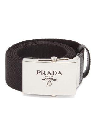 Prada Heren Riemen - Logo-engraved Leather-trimmed Canvas Belt - Mens - Black