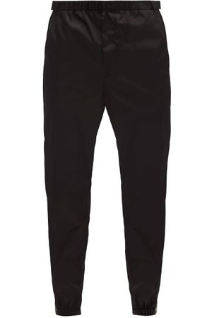 Prada Logo-patch Gabardine Trackpants - Mens - Black