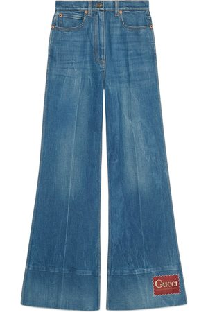 Gucci Dames Wijde broeken - Washed denim flare trousers with label