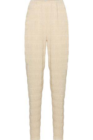 Totême Exclusive to Mytheresa – Smocked high-rise slim pants