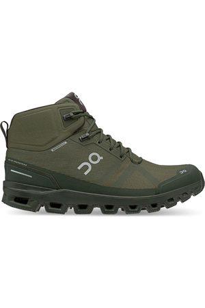 On Running Heren berg/wandelschoenen cloudrock waterproof 23.99615 jungle/fir