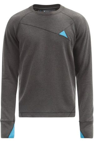 Klättermusen Heren Tops - Huge Jersey Performance Top - Mens - Black