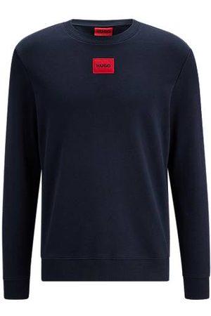HUGO Sweater van katoenen sweatstof met rood logolabel