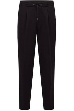HUGO BOSS Relaxed-fit trousers with logo-tape trim