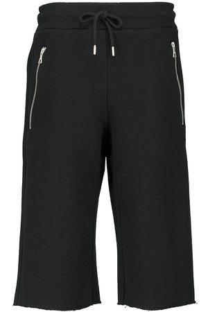 DRIES VAN NOTEN Cropped cotton jersey sweatpants