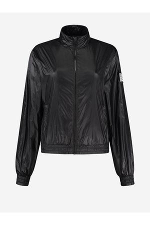NIKKIE by Nikkie Plessen Dames Lange jassen - Zwarte lak jas 32 / Black